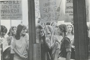 Betty Friedan leads the crowd to a Federal building in NYC